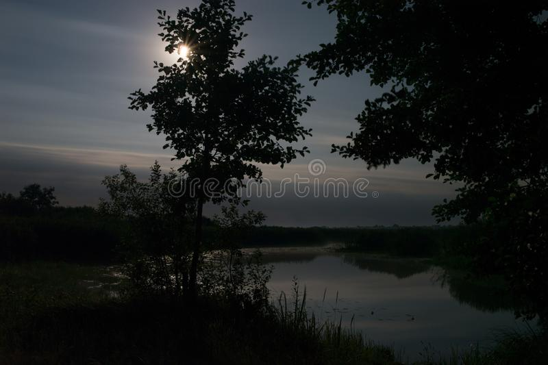 Full moon over foggy river Stochid in Volyn. Moon light at night landscape. Summer night fishing time royalty free stock photos
