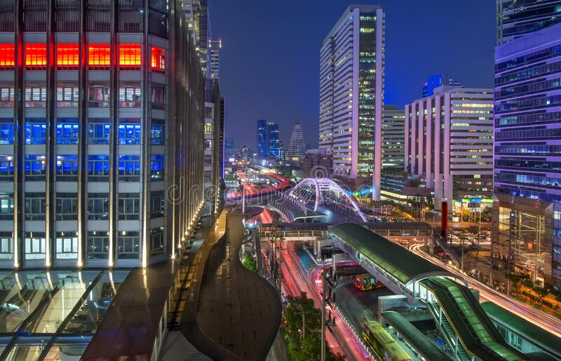 Light on night at Sathorn street intersection is the financial district and business centers in Bangkok Downtown capital of Thaila. Beautiful cityscape light on stock image