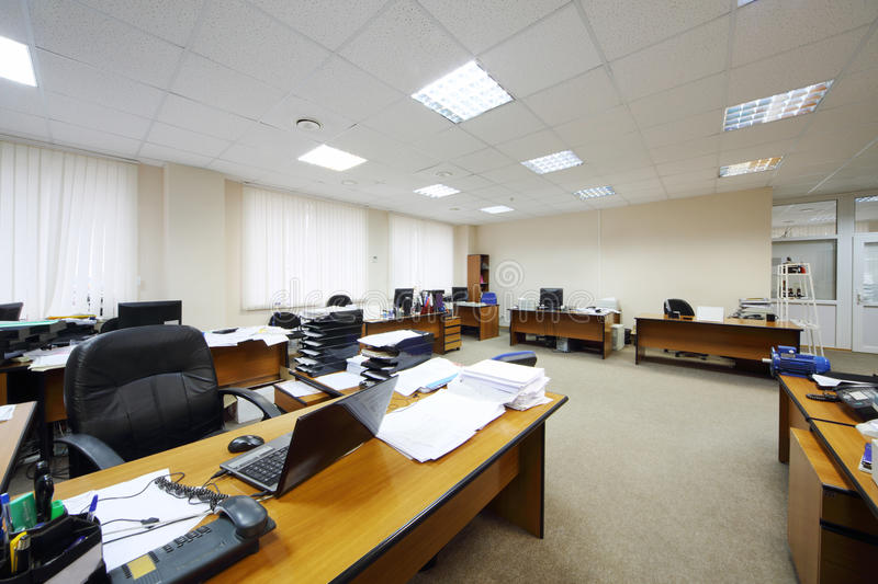 Light office with work desks. Light and spacious office with work desks, computers and big windows stock image