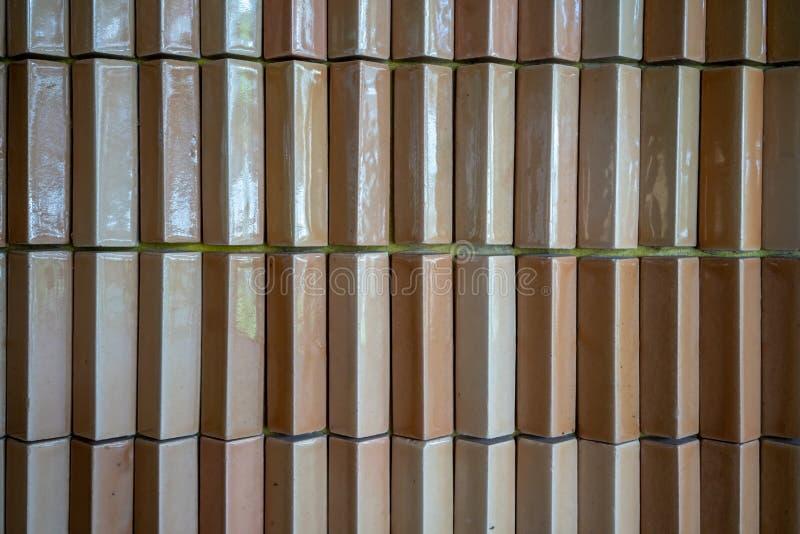 Light orange or brown brick tiles, vintage tiled wall. stock photo