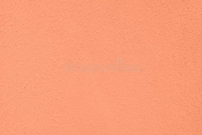 light orange colored low contrast Concrete textured background with roughness and irregularities royalty free stock photo