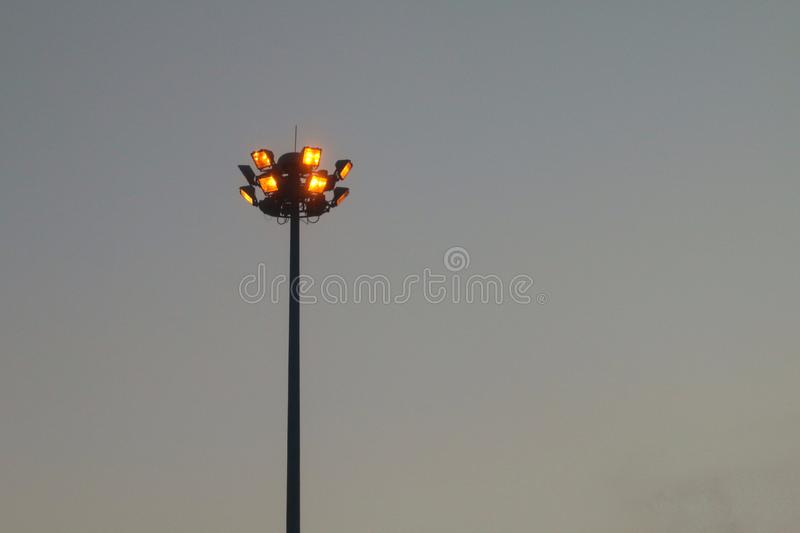 Light orange pole big on the highway, superhighway lighting column at night. The Light orange pole big on the highway, superhighway lighting column at night stock images