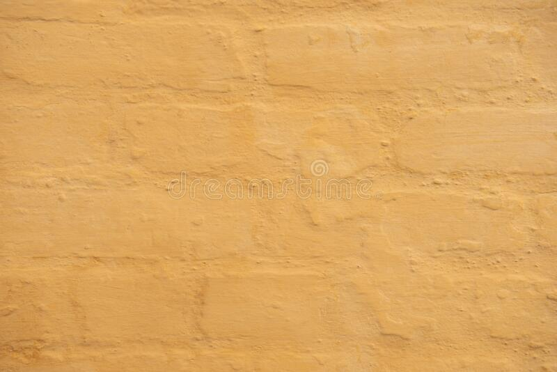 Light Orange Textured Old Brick Wall in the City. Light Orange Textured Brick Wall along the city streets of New Orleans, Louisiana stock image