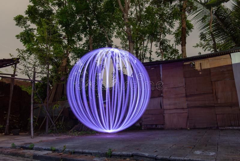 Realistic white ball drawing with light. Light painting, painting with light, light drawing, or light art performance photography are terms that describe royalty free stock photos