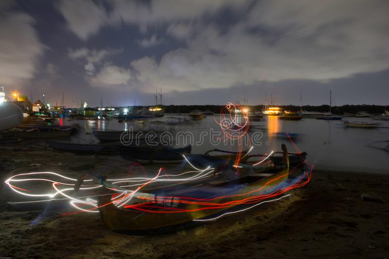 Light painting list on boat burn and bright. Landscape picture of sailors boat on the sea, using light painting on long exposure technique to make bright list stock photo