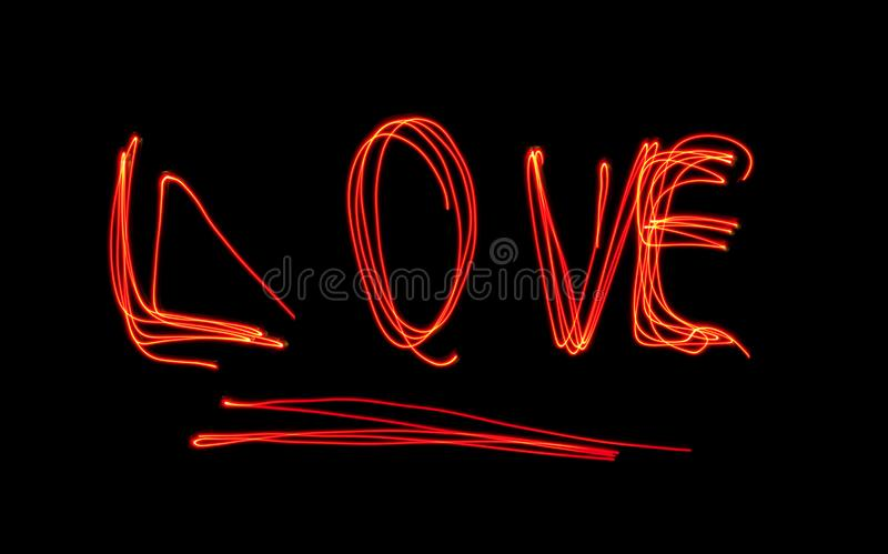 Word LOVE from light painting in the dark. Light painting over black background , Fairy Lights Light Painting royalty free stock images