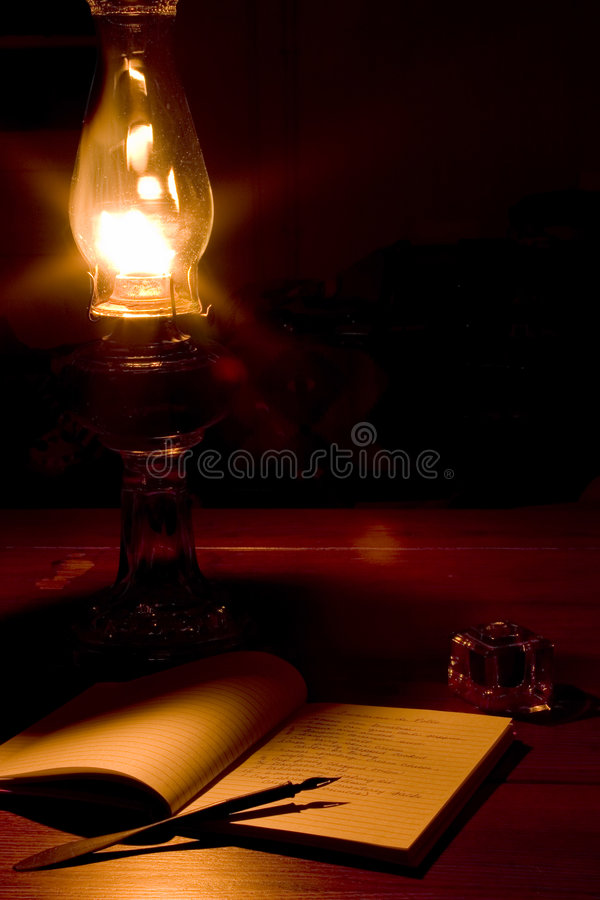 Light of the past. Kerosene lamp with book, pen, & inkwell