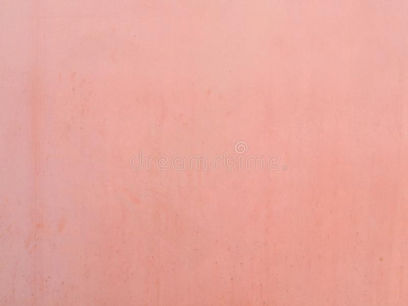 Light pastel pink paint on cement wall texture background royalty free stock photography