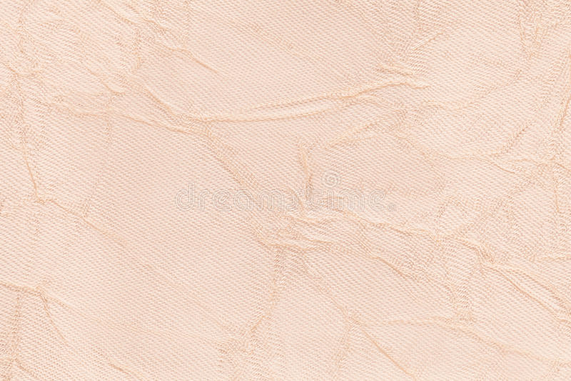 Light pearly wavy background from a textile material. Fabric with fold texture closeup. Light beige wavy background from a textile material. Fabric with fold royalty free stock image