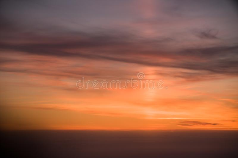 Light pillar. Sunset from the airplane window. Beautiful view. Sky. Red. Colorful. Background. Natural beauty. Outdoor panorama royalty free stock photos