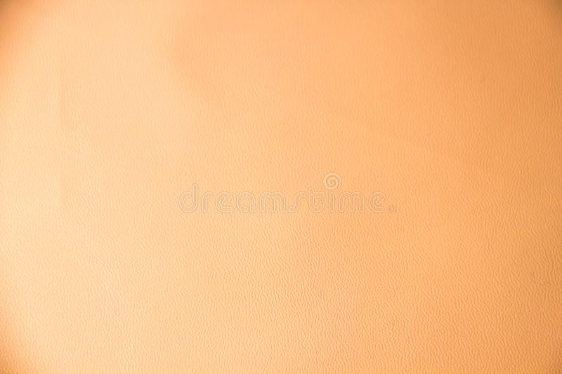 Light pink beige leather texture. Light beige background with natural leather texture closeup royalty free stock images