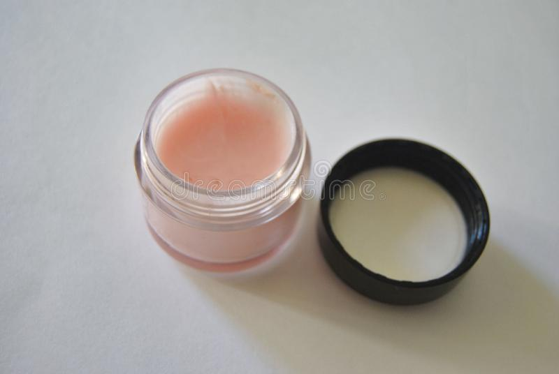 Light pink open cream in a jar stock photo