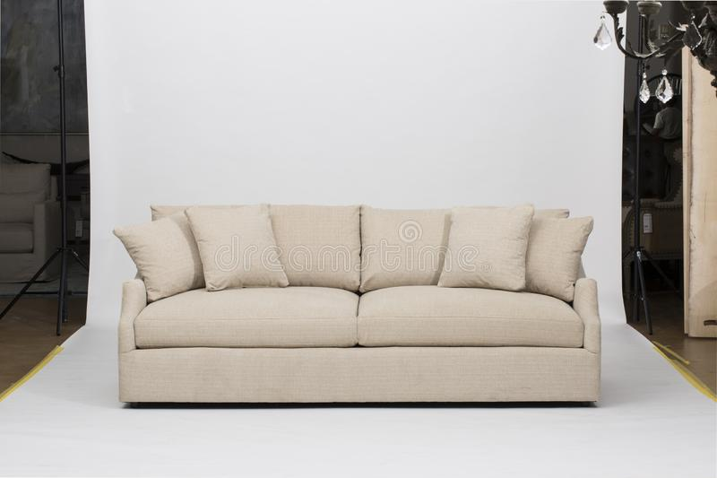 Light pink sofa/sofa bed, Christine Light Gray Loveseat, white and pink pillow with white background - Image.  royalty free stock photography