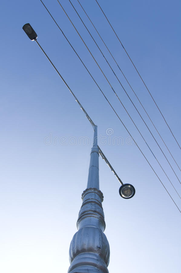 The light pole and electricity cable royalty free stock photography
