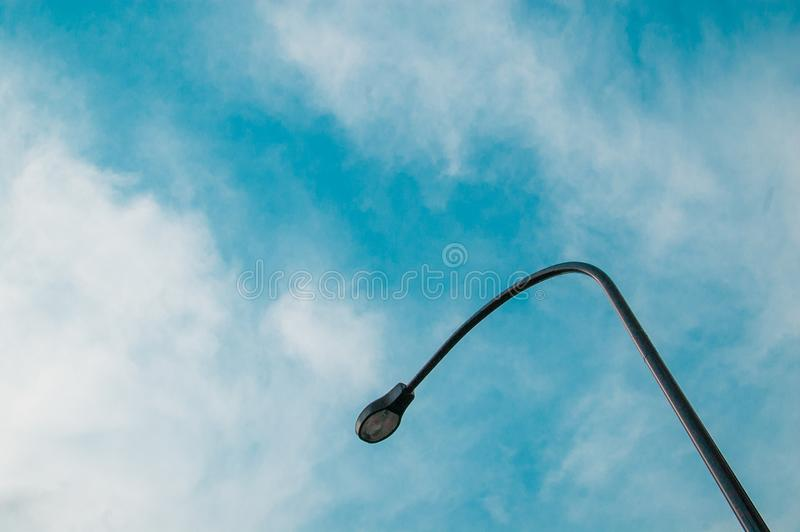 Light Pole on the sky in Shinjuku, Japan. Shinjuku is located in the central of Tokyo and usually there are many people around. In. Summer time, international royalty free stock photo
