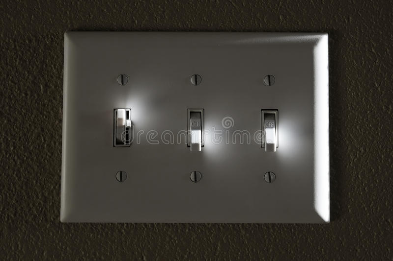 Light or Power Switch on Wall Highlights On and Off stock photography