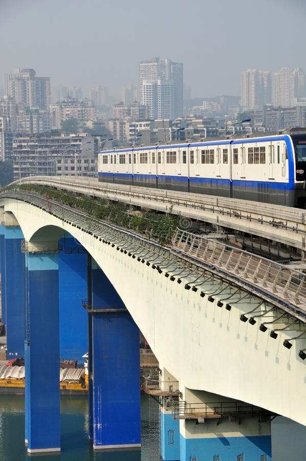 Light Rail Train. One white light rail train is driving on the bridge over Yangze River in Chongqing, China royalty free stock photography
