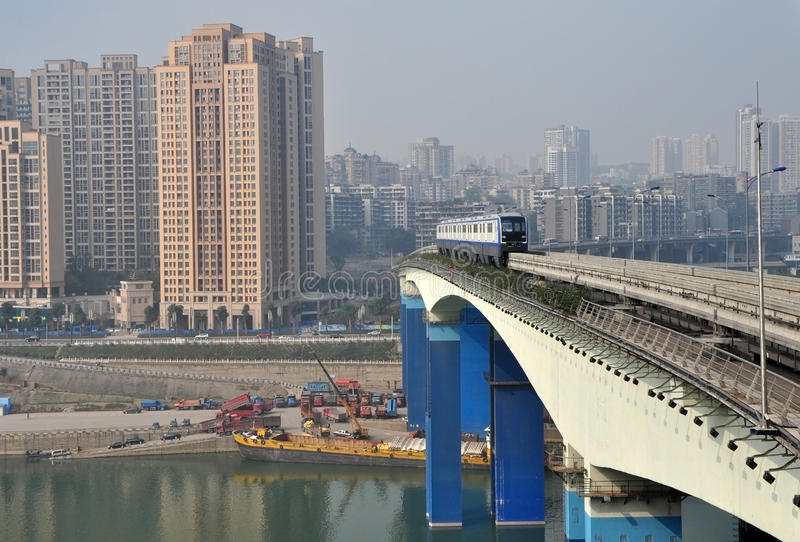Light Rail Train. One white light rail train is driving on the bridge over Yangze River in Chongqing, China stock images