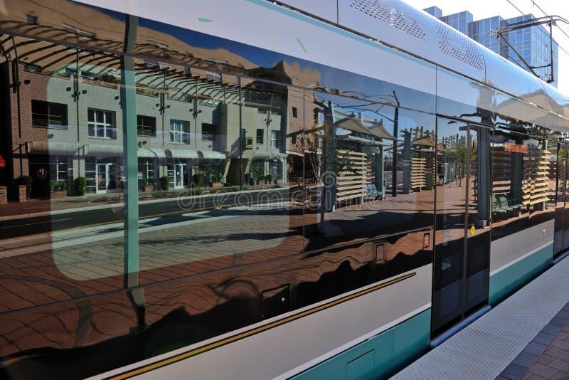 Light rail train carriage. Exterior of metro light rail train carriage reflecting platform in windows, Phoenix, Arizona, U.S.A royalty free stock photo