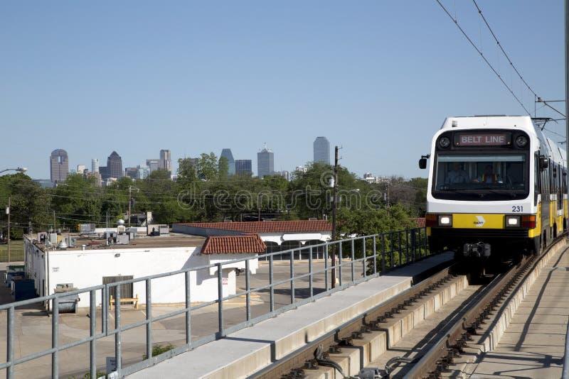Light rail train in city Dallas. Light rail train in Dallas TX, skyline for background royalty free stock photos