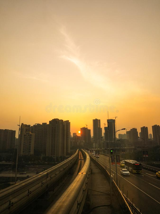 Light Rail Train Tracks. The light rail train station is by the Yangze River.There are two light rail tracks without train at sunset. Taken at Niujiaotuo Station royalty free stock photos