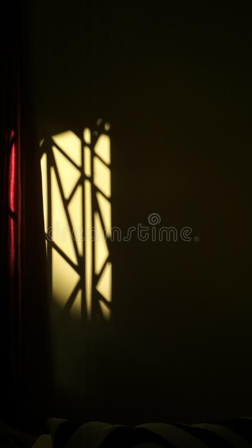 Light rays. Sun light rasy touching the courtain and wall royalty free stock photos