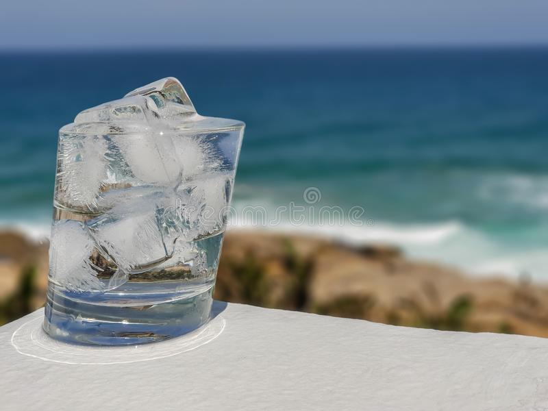 Light reflections at the base of a glass of icy cold water. royalty free stock photo