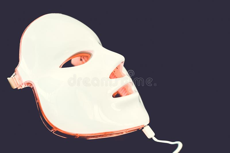 Light rejuvenating mask for facial skin therapy royalty free stock photo