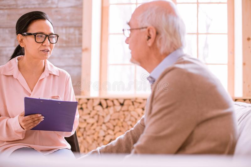 Attentive brunette female talking to her interlocutor stock photography