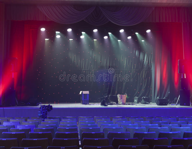 Light from the scene during the concert. Light in the theater, a concert, a circus stock photography