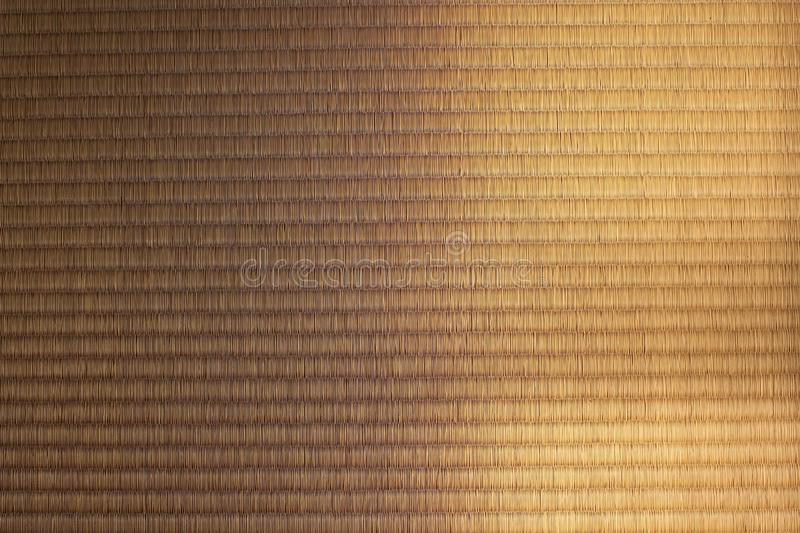 Light and shade on a Japanese tatami mat. Sunlight and shade on a texture of Japanese tatami mat royalty free stock image