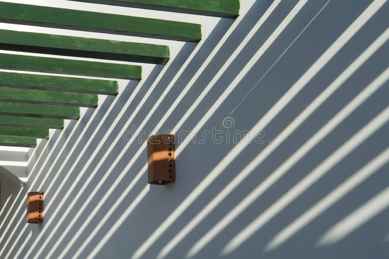 Light and shadow, abstraction. Light and shadow on the white wall, abstraction, light streaks stock photos