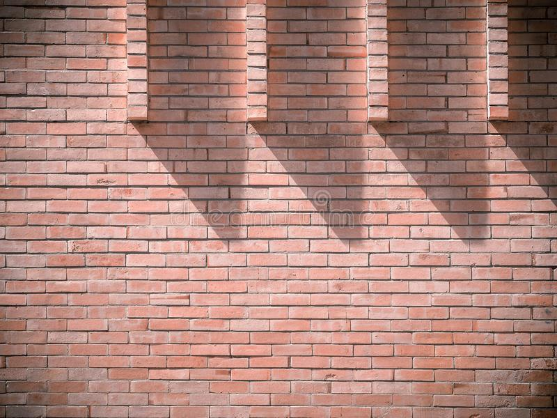 Light and shadows on the brick wall at 10 o`clock. Abstract image background stock images