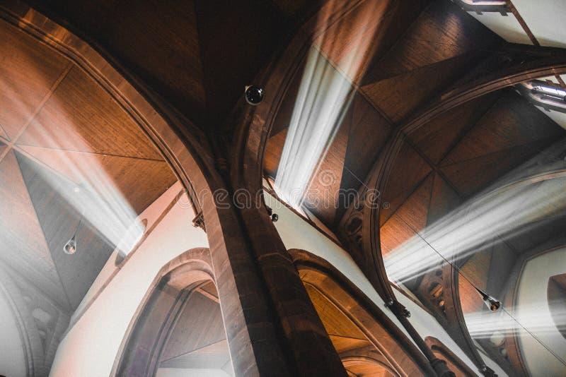 Light shafts stream into church window royalty free stock photos