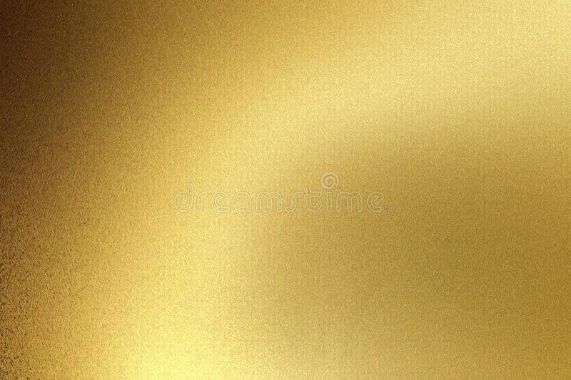 Light shining on gold wave metal plate in dark room, abstract texture background royalty free stock photos