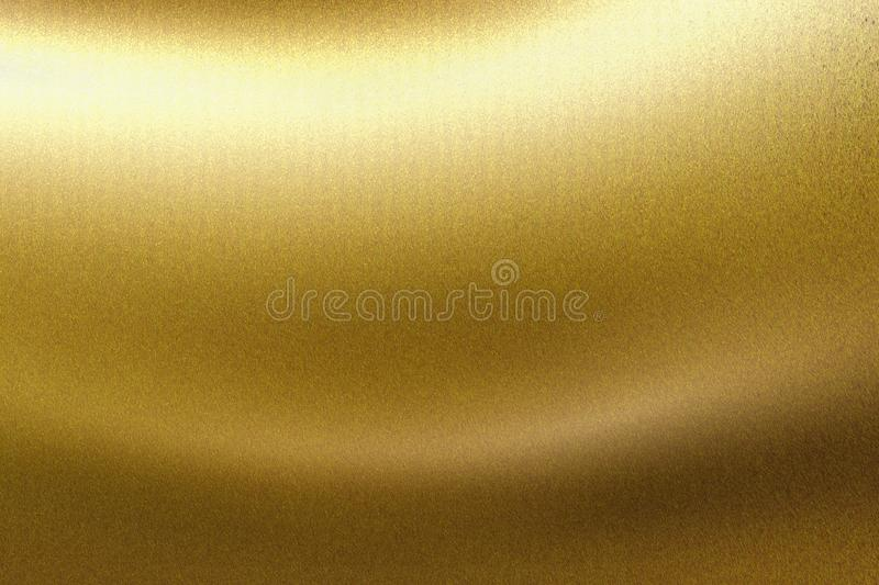 Light shining on gold wave metallic board, abstract texture background.  royalty free stock photos