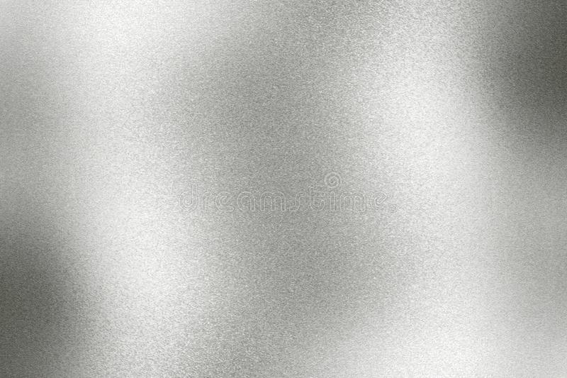 Light shining on old silver metallic wall, abstract texture background royalty free stock photos