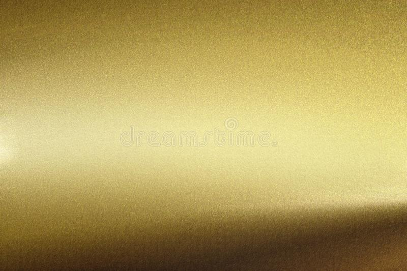 Light shining on rough gold metal wall, abstract texture background.  royalty free illustration
