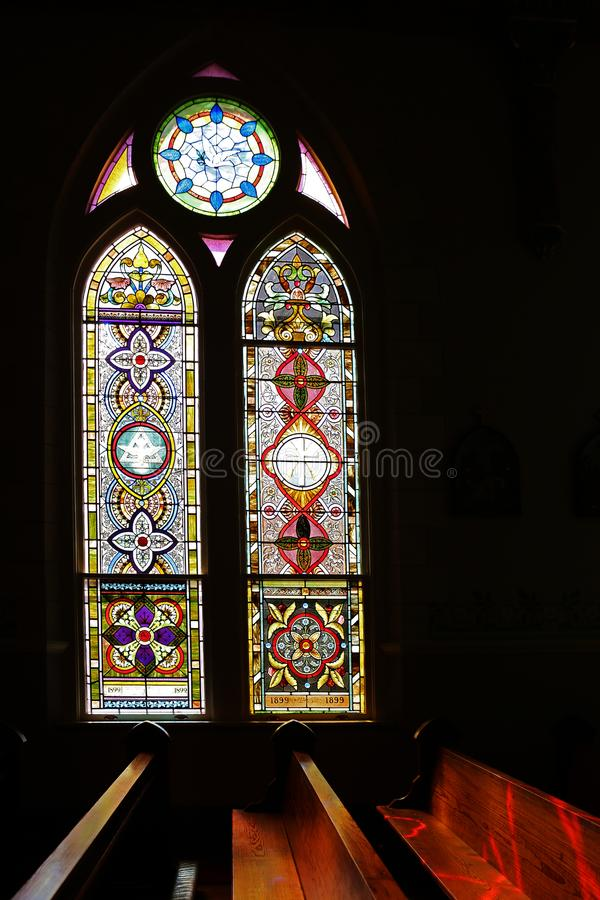 Light shining though stained-glass high gothic window. stock images