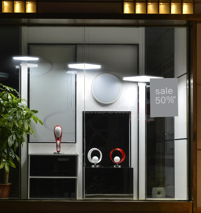 Light shop window,led flat Chandelier,led table lamp,led ceiling lamp,The new light source. In a Light shop window at night,there are led flat Chandelier,led stock images