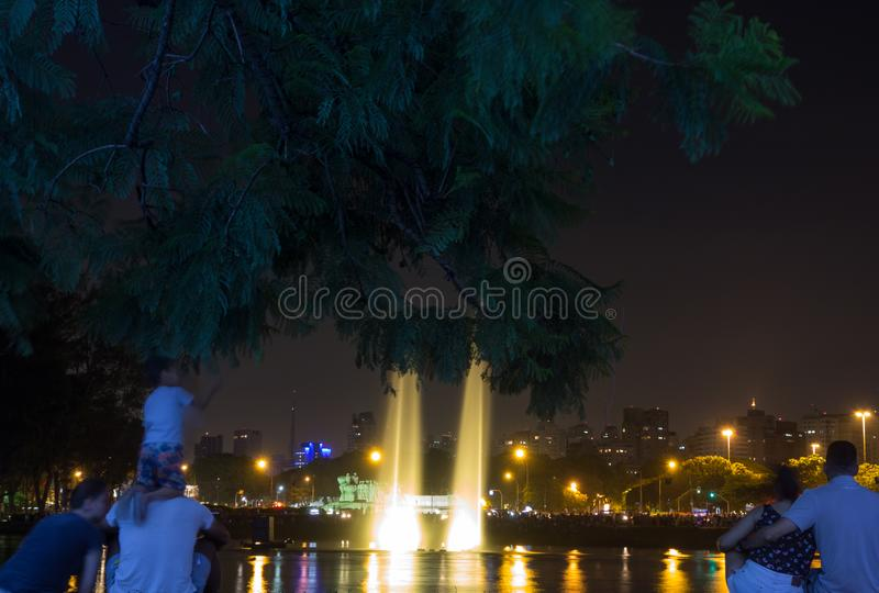 Light show, fountains, spectators. Viewers watching the lights show at the park fountains. ibirapuera park - sao paulo city stock image