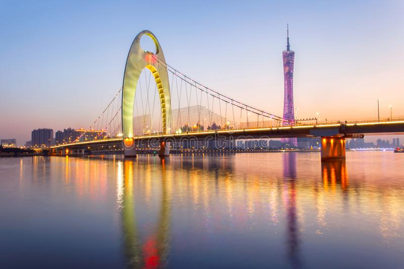 Light show in sunset time at modern bridge in Zhujiang river and modern building of financial district in guangzhou city stock image