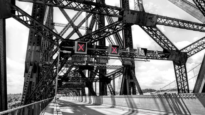 Light signaling inside the Quebec Bridge. Traffic light signage inside the Quebec Bridge, in a vintage decor of metal structures stock images