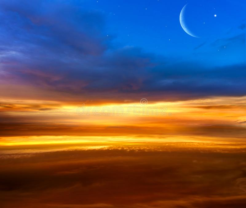Crescent moon with beautiful sunset background . Generous Ramadan . Light from sky . Religion background . stock photos