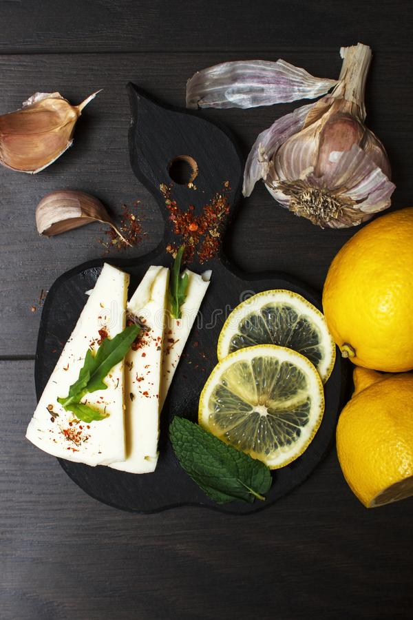 Light snack with white soft cheese, seasonings and herbs in rustic style stock photos