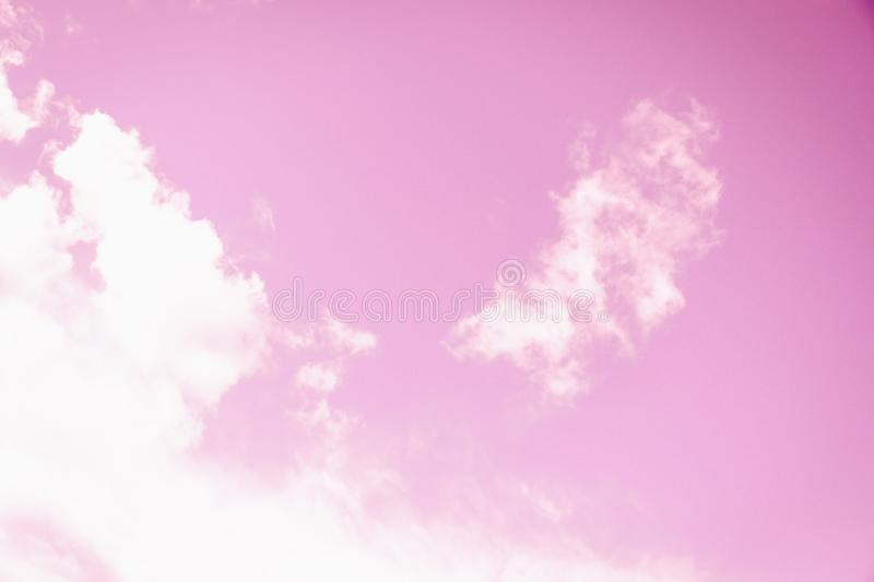 Light soft pink sky background. Angel wings clouds. Light delicate pink sky background. Angel wings clouds royalty free stock photos