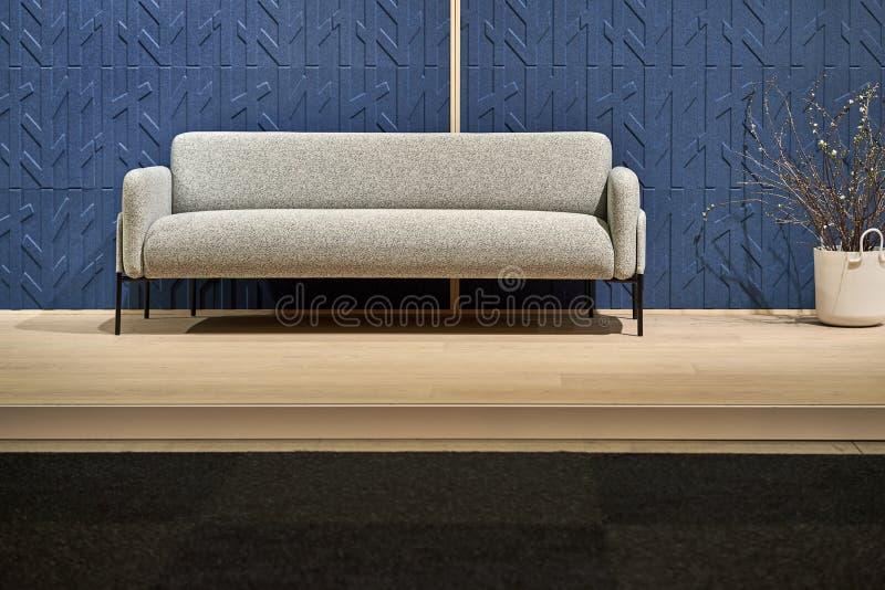 Luminous interior with blue walls and sofa stock photos
