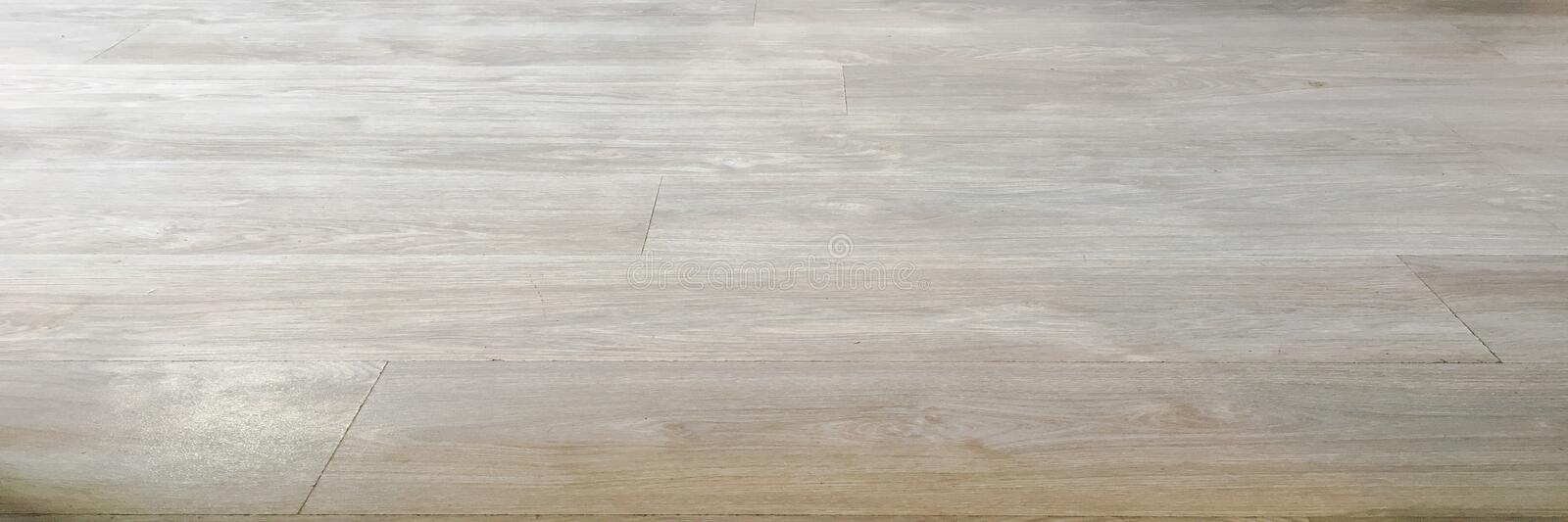 Light soft wood floor surface texture as background, varnished wooden parquet. Old grunge washed oak laminate pattern top view. Light soft wood floor surface stock photo