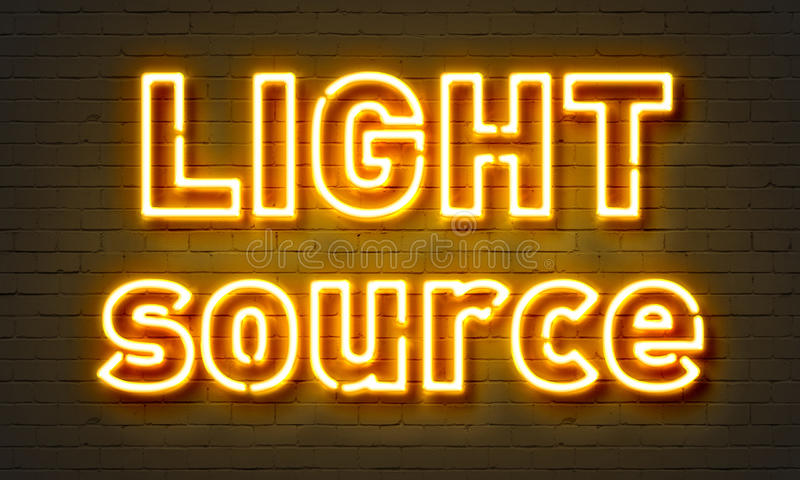 Light source neon sign. On brick wall background royalty free stock photography