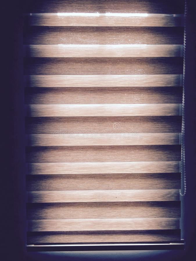 Light source. A picture taken of a window and a curtain where is the only light source in this room stock photo